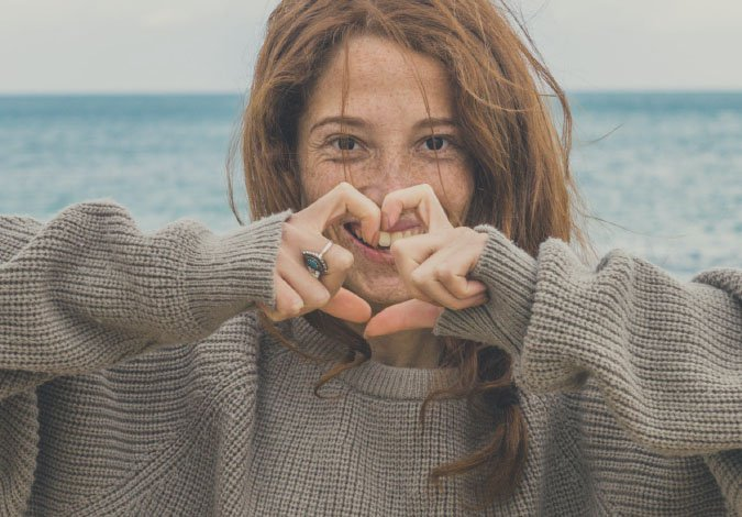 woman making a heart with her hands